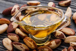 brazil nut on a dark rustic wooden background.
